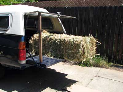 hay bale at the edge of a pickup